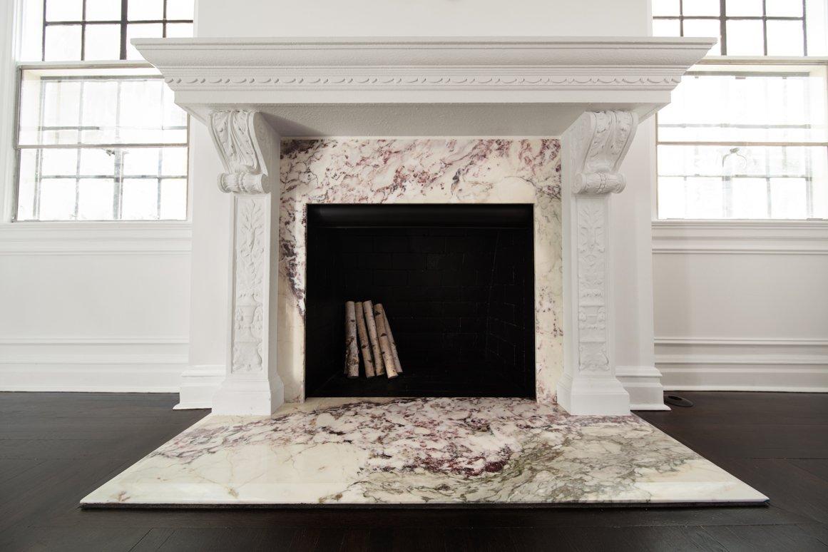 Breccia Marble Tiles Arround Fireplace