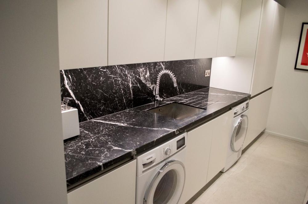 Marquina Marble Tiles In Laundry Room