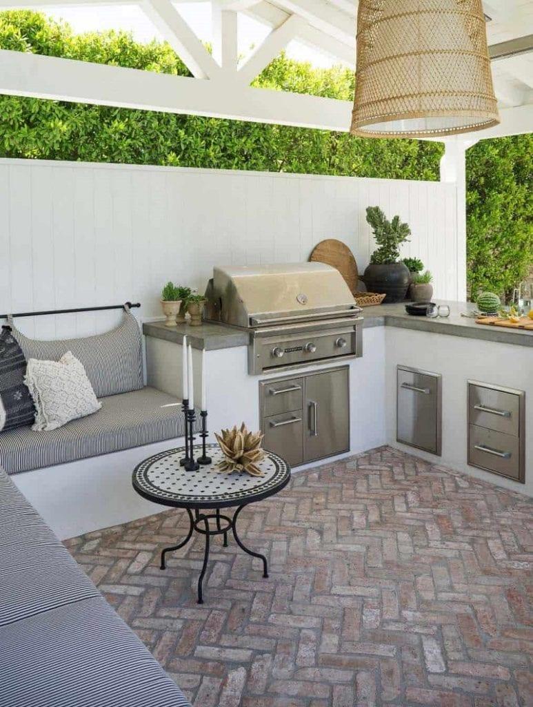 crema marble tiles on outdoor backsplash